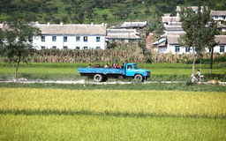 North korean village scenery. Here is the north korean village scenery on the way to Pyongyang.A truck carrying farmers and soldiers traveling on the road in the Stock Photography