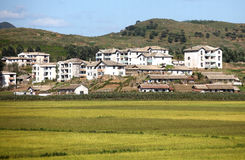 North korean village scenery. Here is the north korean village scenery on the way to Pyongyang.North Korea is a mountainous country,a lot of farmhouses built Stock Photo