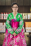 North Korean woman in her traditional dress at Expo 2015 in Mila. MILAN, ITALY - JULY 29: North Korean woman in her traditional dress poses at Expo, universal Royalty Free Stock Images