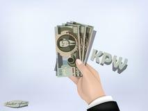 North korean won money paper on hand,cash on hand Stock Photography