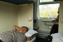 North Koreans sleep & look out window on China-Pyongyang train Royalty Free Stock Photography