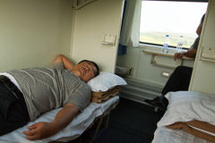 North Koreans sleep & look out window on China-Pyongyang train Royalty Free Stock Photos