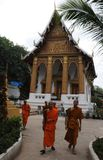 North-Laos: Monks are coming from the monastry college in Luang royalty free stock photo