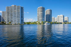 North Miami Waterway. North Miami Intracoastal Waterway with a yacht cruising by and condominiums Royalty Free Stock Images