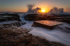 North Narrabeen coastal sunrise with wave splash royalty free stock photography
