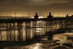 North Pier, Blackpool. England, at Ebb Tide. Blackpool Beech and North Pier during an evening ebb tide. North Pier is the most northerly of the three coastal Royalty Free Stock Images