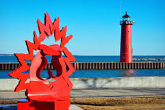 North Pier Lighthouse Kenosha, Wisconsin. This is the red North pier lighthouse with some modern art along Lake Michigan in Kenosha, Wisconsin. It was built in royalty free stock photography