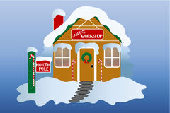 The North Pole. Santa's workshop at the north pole. Decorated for the holiday season with snow on the roof over a gradient blue background Royalty Free Stock Image