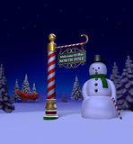 North Pole. Night time snow scene at the north pole featuring the north pole sign post next to a snowman surrounded by evergreens and Santa's sleigh in the Royalty Free Stock Images