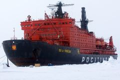Nuclear-powered icebreaker took expedition to North pole. North pole - 2 July 2016: Nuclear-powered icebreaker took expedition of travelers to North pole Stock Image