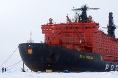 Nuclear-powered icebreaker took expedition to North pole. North pole - 2 July 2016: Nuclear-powered icebreaker took expedition of travelers to North pole Royalty Free Stock Photos