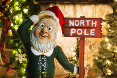 North Pole residence of Santa Claus. Picture of a dwarf  with a tag North Pole Stock Photo