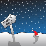 North Pole Signpost and Santa Hat Royalty Free Stock Photography