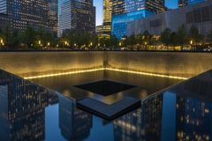 The North Pool of the 9/11 Memorial at dusk in Lower Manhattan, royalty free stock photos