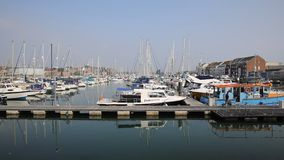 North Quay marina Weymouth Dorset UK with boats and yachts on a calm summer day stock video footage