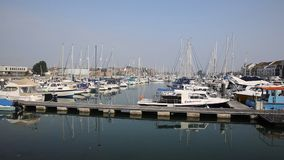 North Quay Weymouth Dorset UK with boats and yachts on a calm summer day stock video footage