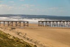 North Sands Beach, Hartlepool, UK. A broken pier at the North Sands Beach, Hartlepool, UK royalty free stock image