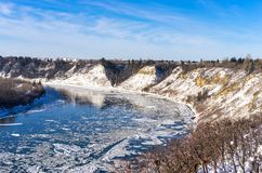 North Saskatchewan river valley in winter season. North Saskatchewan river valley natural area south of Fort Edmonton bridge, in the golden light of evening stock image