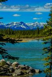 North Saskatchewan river, aylmer Provincial Recreation Area, Alberta, Canada. North Saskatchewan river captured from the shore with mountains and partially royalty free stock images
