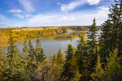 North Saskatchewan river with island. Alberta rural landscape with harvested field and north Saskatchewan river bank and island royalty free stock photo