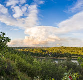 North Saskatchewan river Valley. Leading to downtown of the city of Edmonton with one predominant heavy cloud and blue sky background royalty free stock photography