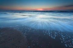 North sea beach in dusk Stock Photos