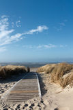 North Sea Beach on Langeoog. Path to the beach on Langeoog through the dunes with the North Sea in the background Stock Photography