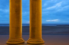North Sea beach of Ostend with columns, Belgium stock images