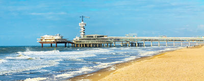 North Sea beach and Scheveningen Pier near Hague, Holland. Netherlands banner panoramic royalty free stock photography