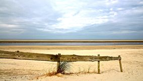 North-sea beach with wooden fencing Stock Photos