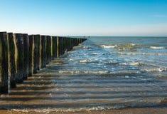 North Sea breakwater at low tide Stock Photos