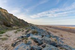 North Sea coast in California, Norfolk, England, UK. The beach and stones of California, near Caister-on-Sea, Norfolk, England, UK stock photo