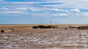 North Sea coast in Cambois, England, UK. North Sea coast in Cambois, Northumberland, England, UK - the beach with wind turbines in the background royalty free stock photography