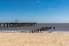 North Sea coast in Kirkley, Lowestoft, Suffolk, England, UK. With the Claremont Pier and a wave breaker royalty free stock image