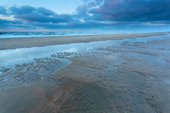 North sea coast at low tide in dusk Stock Photography
