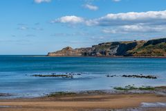 North Sea Coast in Runswick Bay, England, UK. North Sea Coast in North Yorkshire, England, UK - looking from Runswick Bay towards the former quarry in Kettleness stock photos