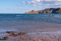 North Sea Coast in Runswick Bay, England, UK. North Sea Coast in North Yorkshire, England, UK - looking from Runswick Bay towards Kettleness stock images