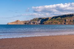 North Sea Coast in Runswick Bay, England, UK. North Sea Coast in North Yorkshire, England, UK - looking from Runswick Bay towards the former quarry in Kettleness royalty free stock images