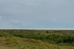 North Sea with drilling rigs as seen from Schiermonnikoog stock photos