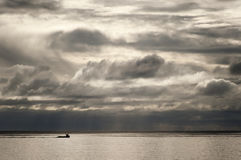 North Sea Fishing Boat. Fishing boat against a dramatic sky over the North Sea in Scotland Stock Photos