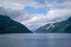 North sea fjord view with green steep shores. Royalty Free Stock Photo