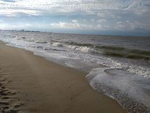 North Sea Monroe beach Bruges Belgium. Sand dunes and path and texture and waves royalty free stock images