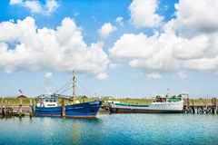 North Sea in Nordfriesland, Schleswig-Holstein, Germany. Traditional fishing boats lying in harbor at North Sea in Nordfriesland, Schleswig-Holstein, Germany royalty free stock photography