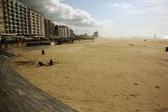 North Sea resort (Oostende, Belgium). Oostende, North Sea resort in Belgium. Wide sandy beach and buildings from the 1970-ies Royalty Free Stock Photos