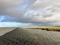 North Sea Shore in East Frisia Ostfriesland with Dramatic Clouds and Light stock images
