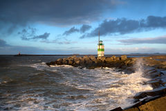 North sea waves and lighthouse in Ijmuiden Royalty Free Stock Images