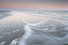 North sea waves at sunrise Stock Image