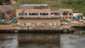 North Shields, Tyne and Wear, England, UK. September 05, 2018: View from the River Tyne at derelicted harbour buildings stock photos