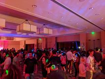 People dance at Silent Disco Dance party. North Shore, Hawaii - March 2, 2018: Silent Disco Dance party at Music festival Wanderlust yoga event on the North stock photo