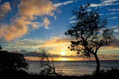 North Shore Hawaii Sunset. Sunset on the shores of the Pacific Ocean on Oahu`s North Shore in Hawaii stock image